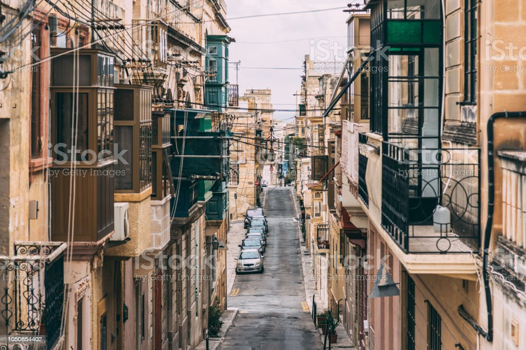 Street view in Birgu with traditional balconies, Malta stock photo