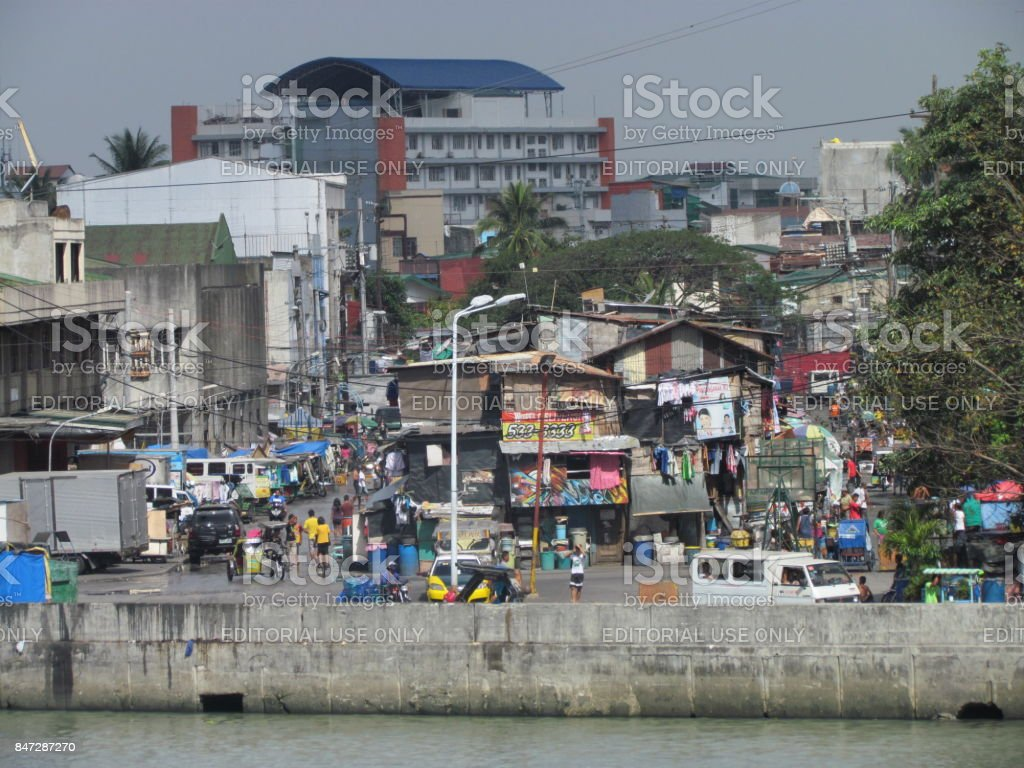 Street view in poor neighborhood in Manila stock photo