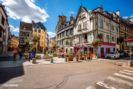 Cozy square with beautiful buildings and cafes in Rouen city, the capital of Normandy region in France