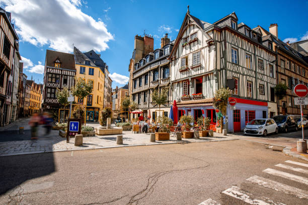 Street view in Rouen old town, France Cozy square with beautiful buildings and cafes in Rouen city, the capital of Normandy region in France normandy stock pictures, royalty-free photos & images