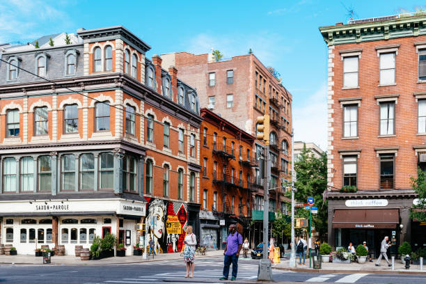 street view of bowery in east village of new york city - lower east side manhattan stock pictures, royalty-free photos & images