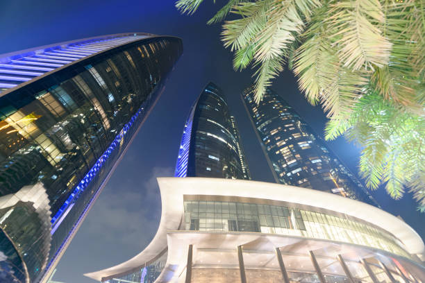 ABU DHABI - DECEMBER 7, 2016: Street view of Downtown Abu Dhabi at night. The city attracts 10 million tourists annually ABU DHABI - DECEMBER 7, 2016: Street view of Downtown Abu Dhabi at night. The city attracts 10 million tourists annually. annually stock pictures, royalty-free photos & images
