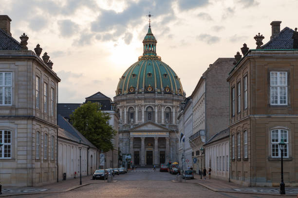 COPENHAGEN, DENMARK - 24 JUN 2016: Street view of Frederik's Church, popularly known as The Marble Church for its rococo architecture, is an Evangelical Lutheran church stock photo