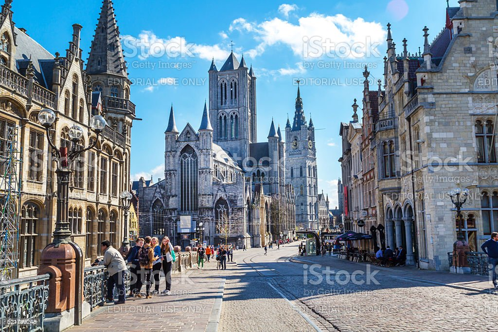 Street view of Ghent, Belgium with St Nicholas' Church stock photo