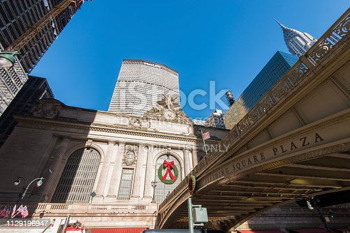 Street view of Grand Central Station, Pershing Square bridge, Chrysler and Metlife Building during Christmas season at Manhattan, New York City, USA.