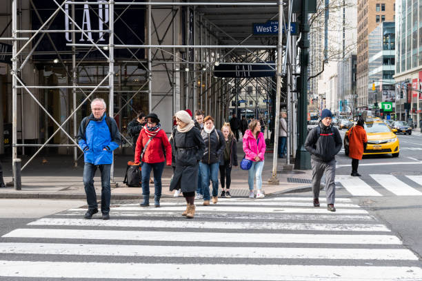 Street view of Herald Square in New York City with GAP store people and pedestrians on 34th street stock photo