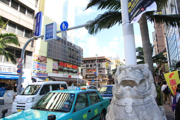 Street View of Naha's Kokusai-dori (International Street) in Naha, Okinawa, Japan Okinawa, Japan – October 26, 2019: Kokusai-dori is the main shopping street in Naha with numerous souvenir shops and restaurants naha okinawa stock pictures, royalty-free photos & images
