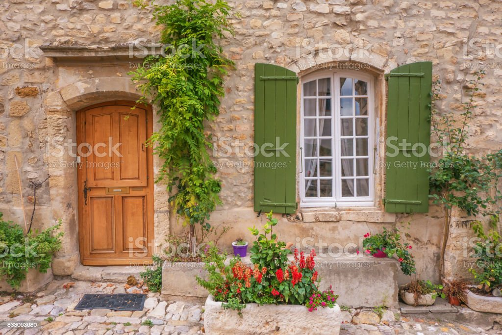 Street view of quaint old-fashioned house facade. Provence, France. stock photo