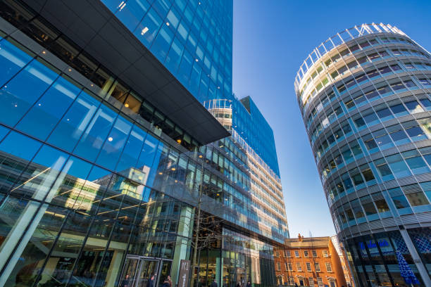 Street view of Spinningfields, a modern area was specially developed in the 2000s as a business, retail and residential development of Manchester. stock photo