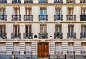 istock Street view of the elegant facade of an old apartment building in a residential neighborhood of Paris. Vintage style photo. 1054580508