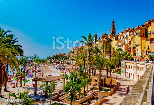 Menton, Provence-Cote d'Azur, France - August 11, 2018: View of the promenade and the ancient village in the background.