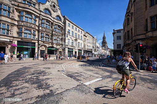 August 5, 2018 A young woman cyclist crossing the street, Oxford, England, UK.