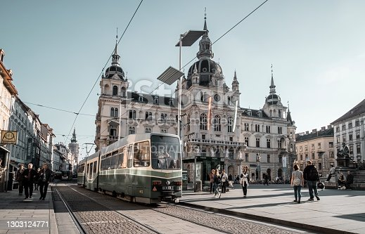 Graz, Austria- October 28, 2019: Street view. Tram on Hauptplatz square in Graz. Graz is a historic city, many ancient buildings can be seen everywhere in the city center. Graz becoming the 2003 European Capital of Culture.