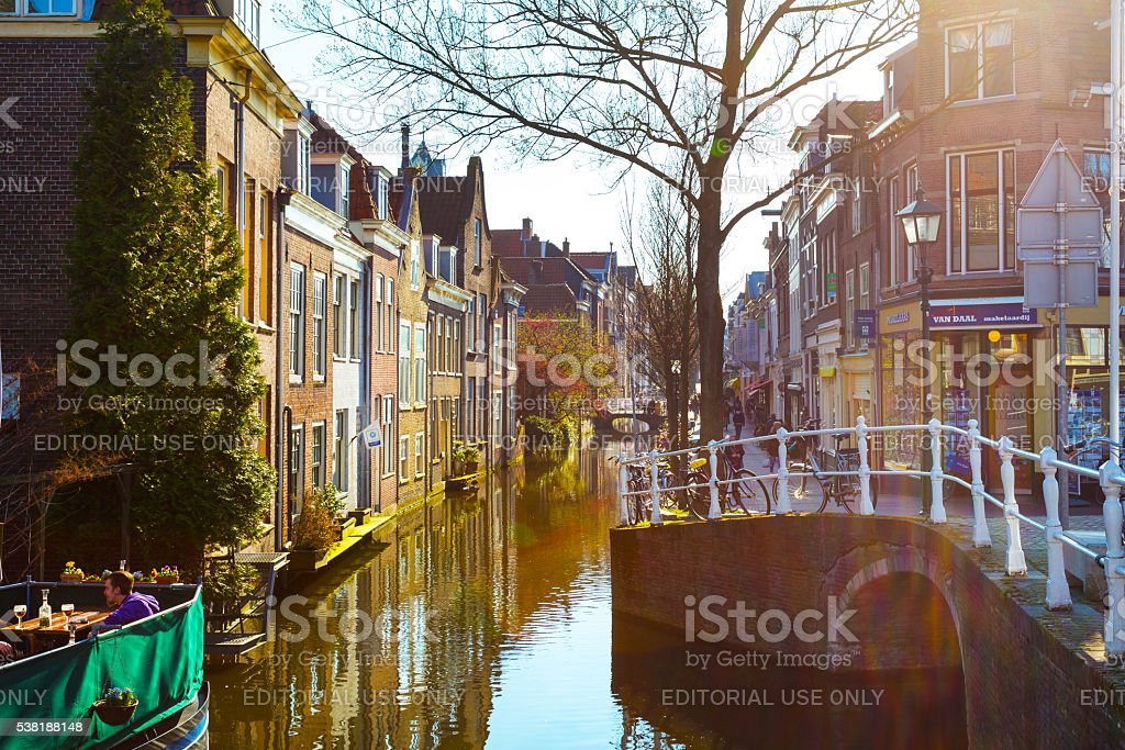Street view with houses and canal in Delft, Holland at stock photo