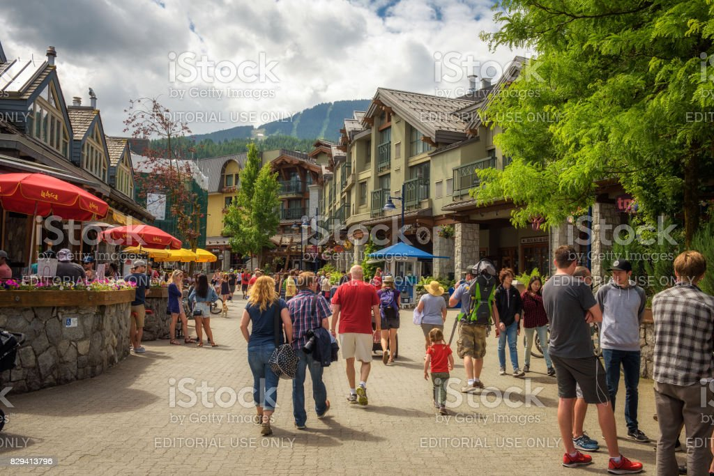 Street view with many tourists  in Whistler Village stock photo