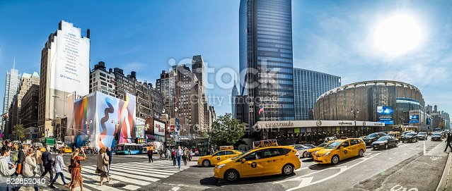 Ney York, USA - October 21, 2015: street view with people at Madison Square Garden, Manhattan, New York City, USA. New York is the most populous city in the United States.