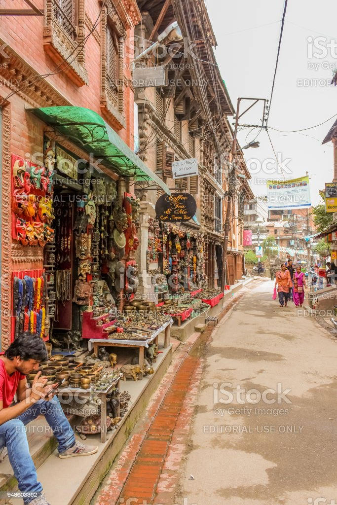 Street view with souvenir shops and walking Nepalese people in Lalitpur metropolitan city stock photo