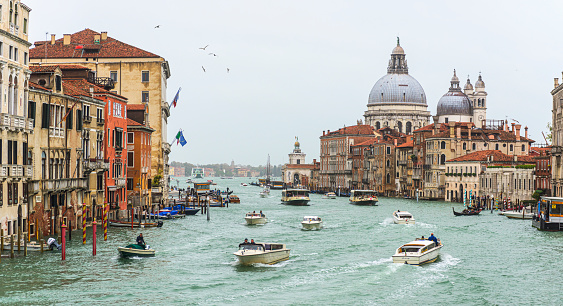 Street views of the grand canal and ancient architecture in Venice, during acqua alta