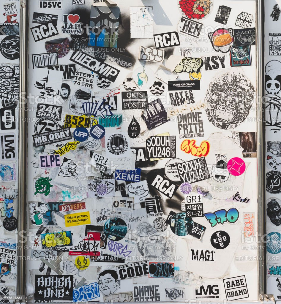 : Street wall covered numerous multicolored stickers. royalty-free stock photo