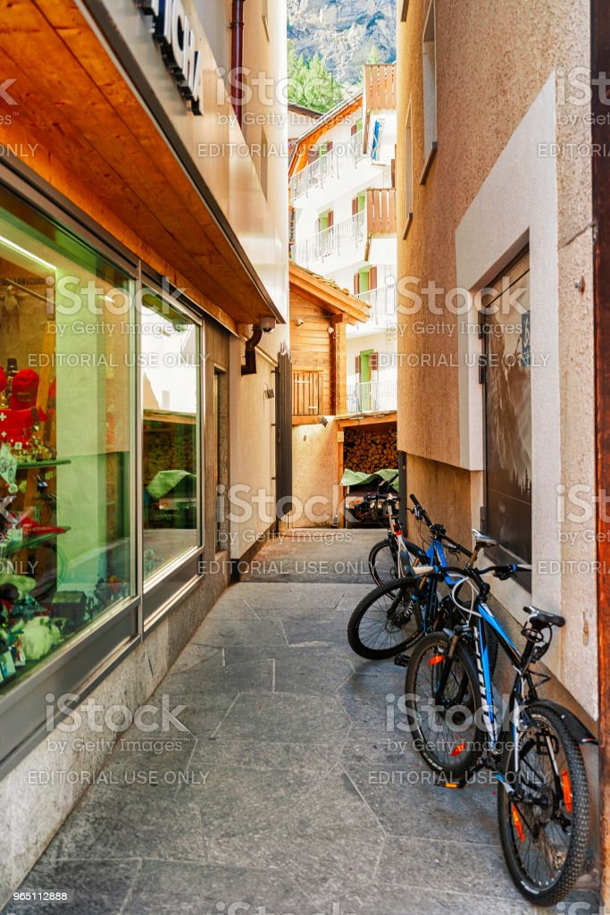 Street with bicycles at center of Zermatt Switzerland in CH royalty-free stock photo