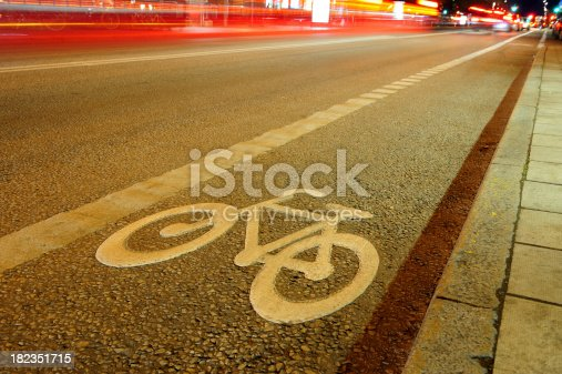 929609038istockphoto Street with bike lane at night 182351715