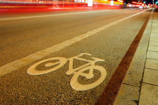 929609038 istock photo Street with bike lane at night 182351715