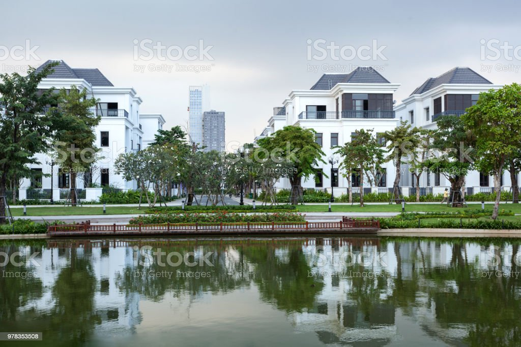 Street with brand new suburban affordable white houses stock photo