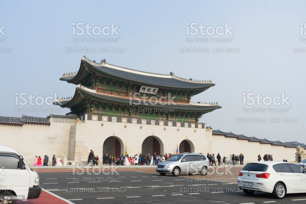 Street with cars in front of the gate of the Gyeongbokgung Palace royalty-free stock photo