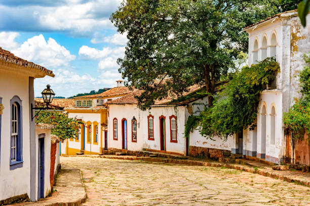 Street with cobblestones and some houses with colonial architecture stock photo