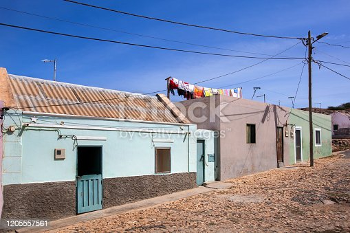 Street with colorful houses in and fresh washed laundry in Bofareira on the island Boa Vista of Cape Verde