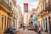 Havana, Cuba - December 22, 2015: A Cuban flag with holes waves over a street in Central Havana.