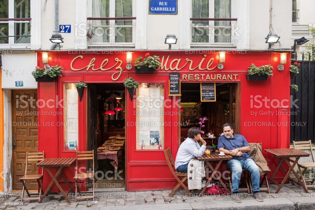 Street With French Restaurants In Paris France Stock Photo More