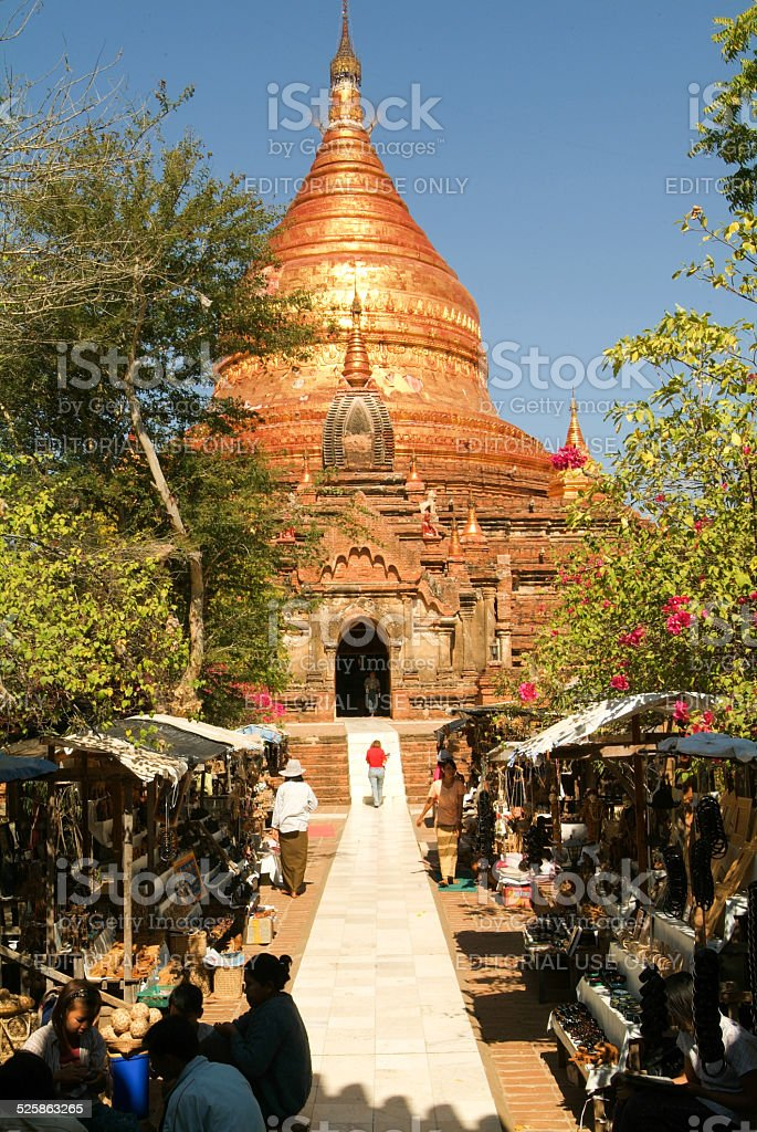 Street with gift shops in front of Dhammayazika pagoda stock photo