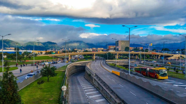 Street with highways and tunnels and bridges in Bogota Colombia Street with highways and tunnels and bridges in Bogota Colombia bus rapid transit stock pictures, royalty-free photos & images