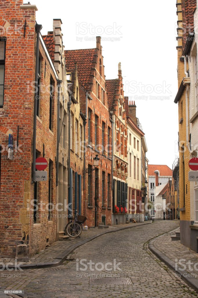 Street with historic medieval buildings, Bruges, Belgium stock photo