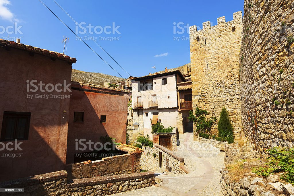 Street with old fortress wall in Albarracin. Aragon, Spain
