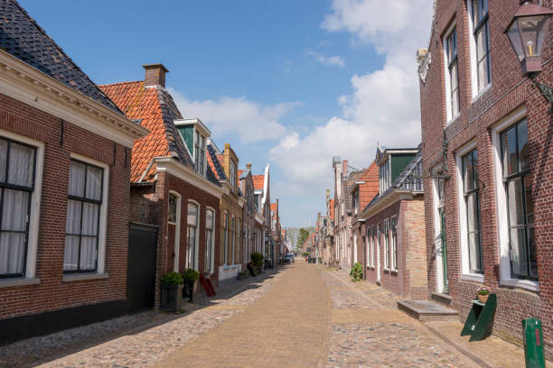 Street with old houses in a a historical city in the lake side district of the Netherlands. stock photo