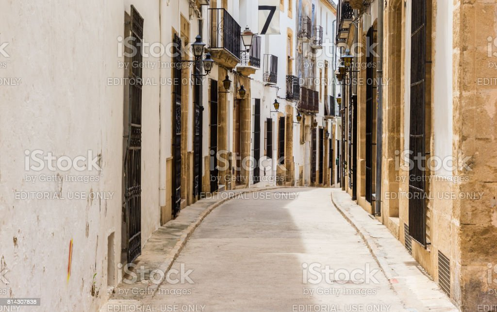 Street with old houses in the center of Javea, Spain stock photo