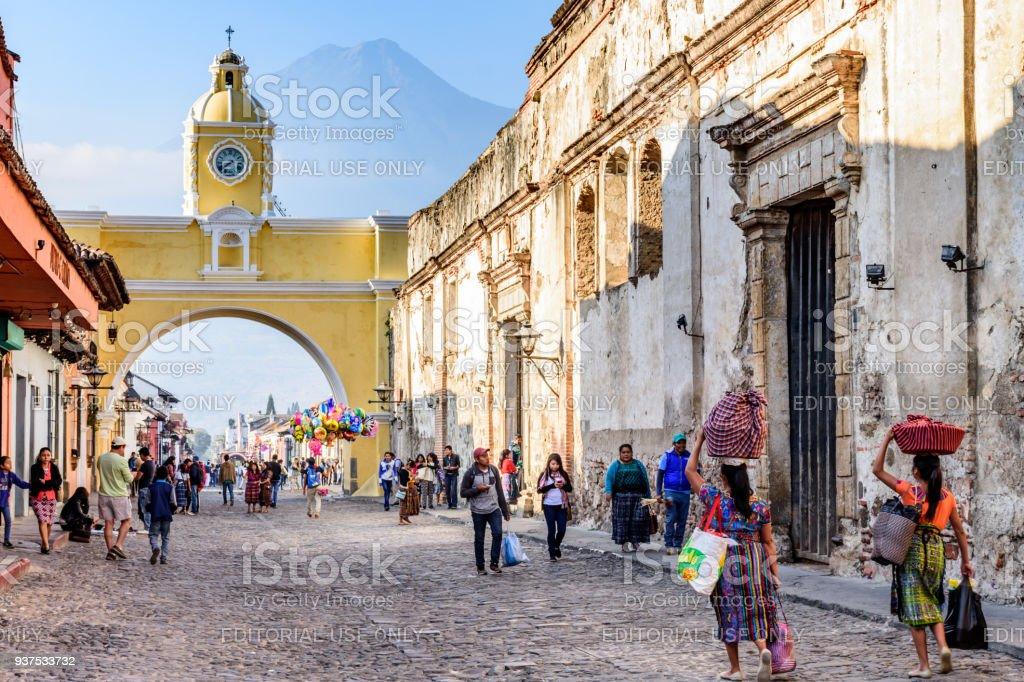 Street with Santa Catalina arch, ruins & volcano, Antigua, Guatemala stock photo
