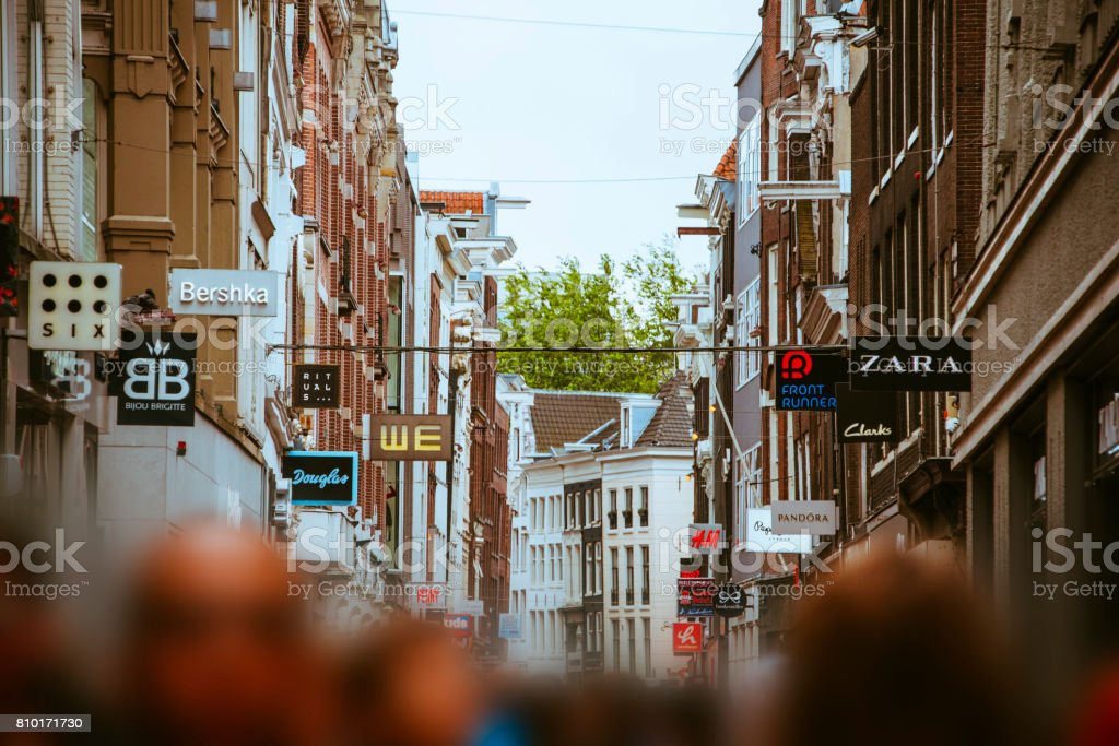 Street with stores in Amsterdam stock photo