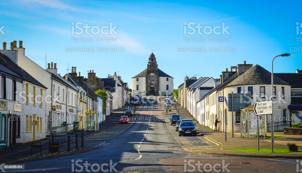 Street with traditional houses and round church, Bowmore, Islay, United Kingdom stock photo