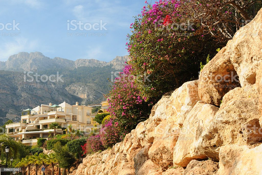 Street with typical  style holiday apartments in Costa Blanca stock photo