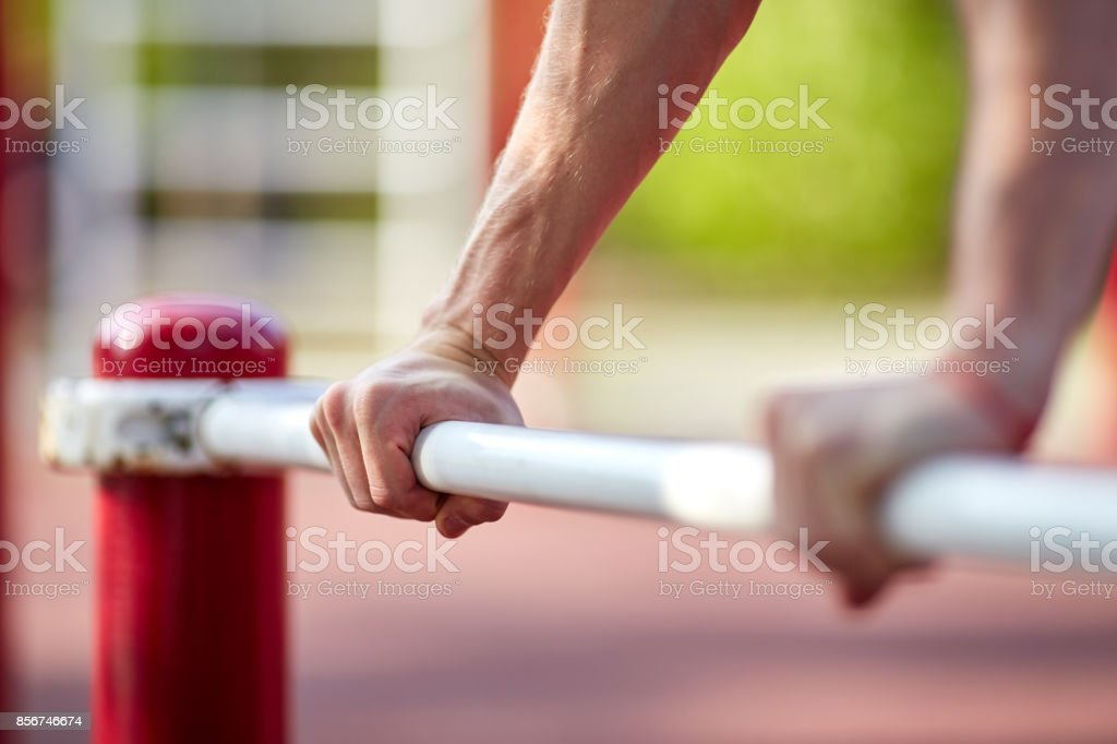 Street workout - handsome muscular man workout in the park. stock photo