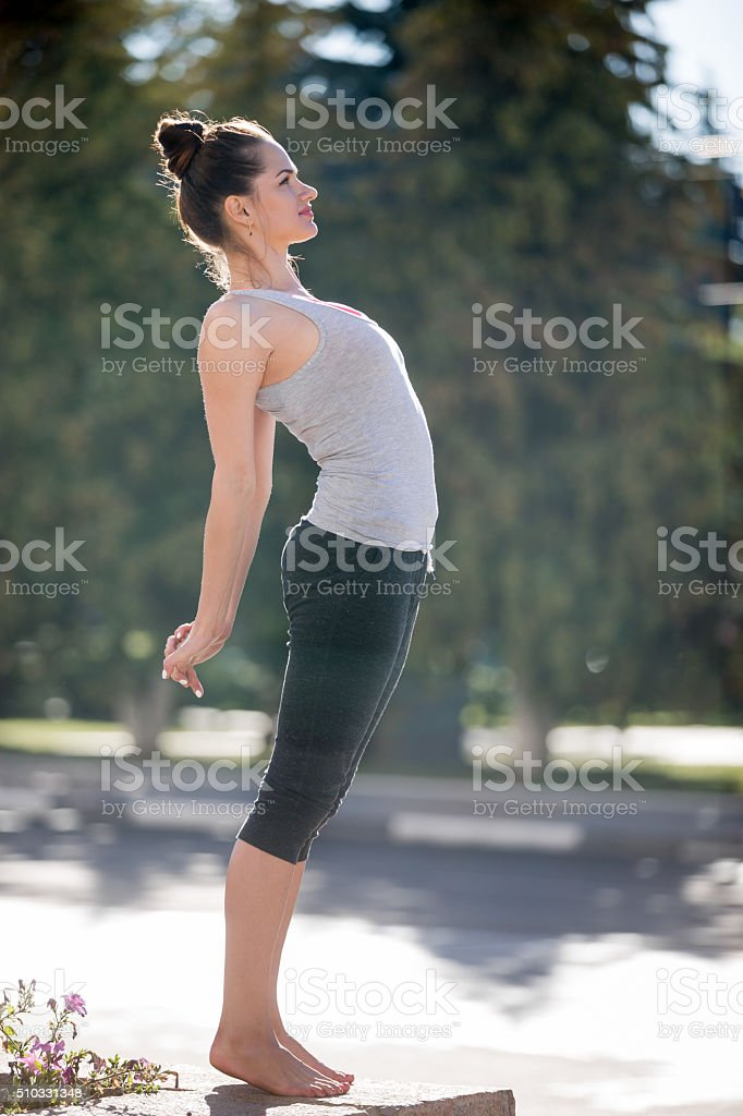 Street yoga: Ardha Chakrasana pose stock photo