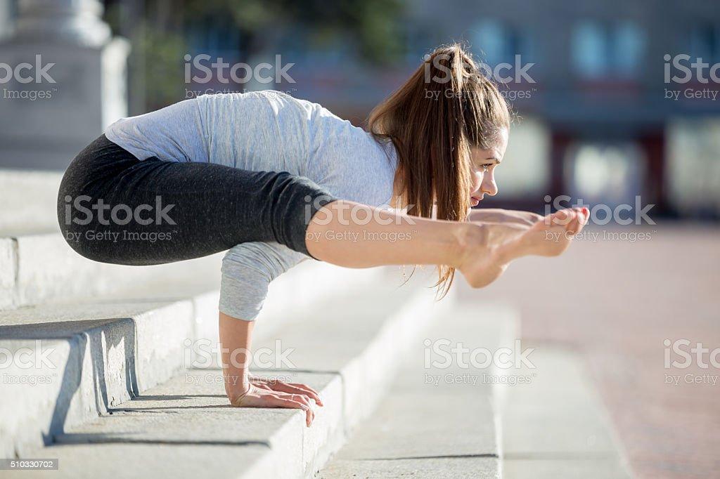 Street yoga: Tittibhasana stock photo