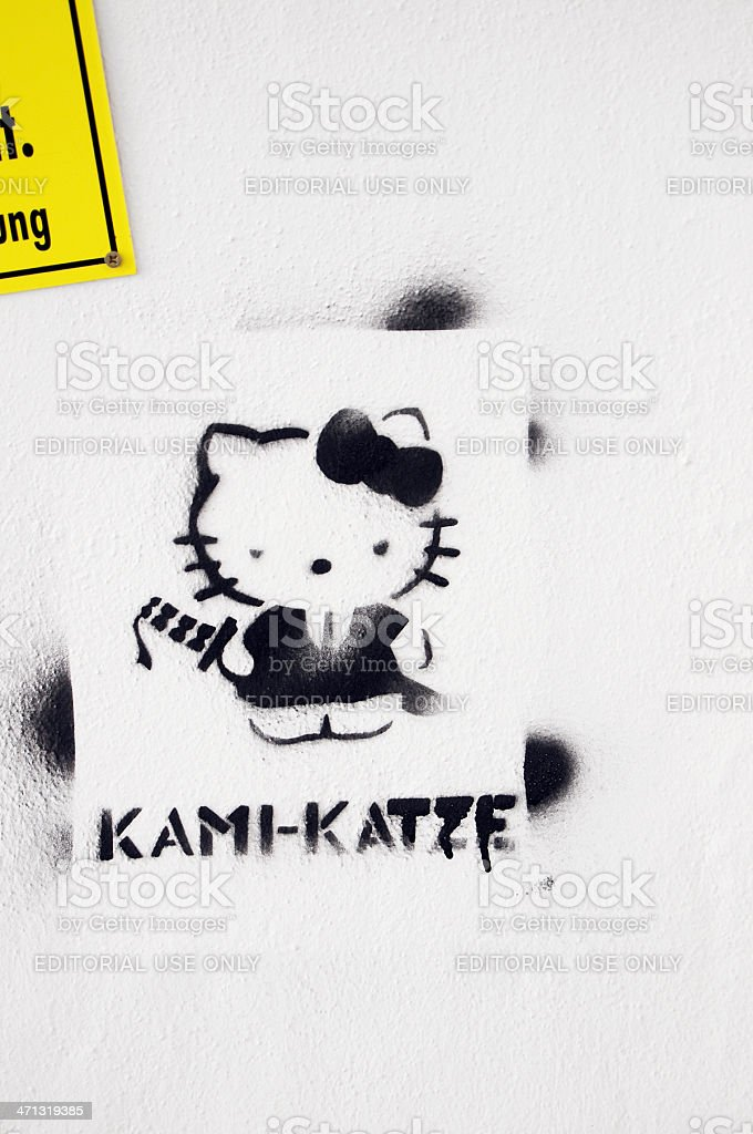 Streetart graffiti of a comic cat kami-katze stock photo
