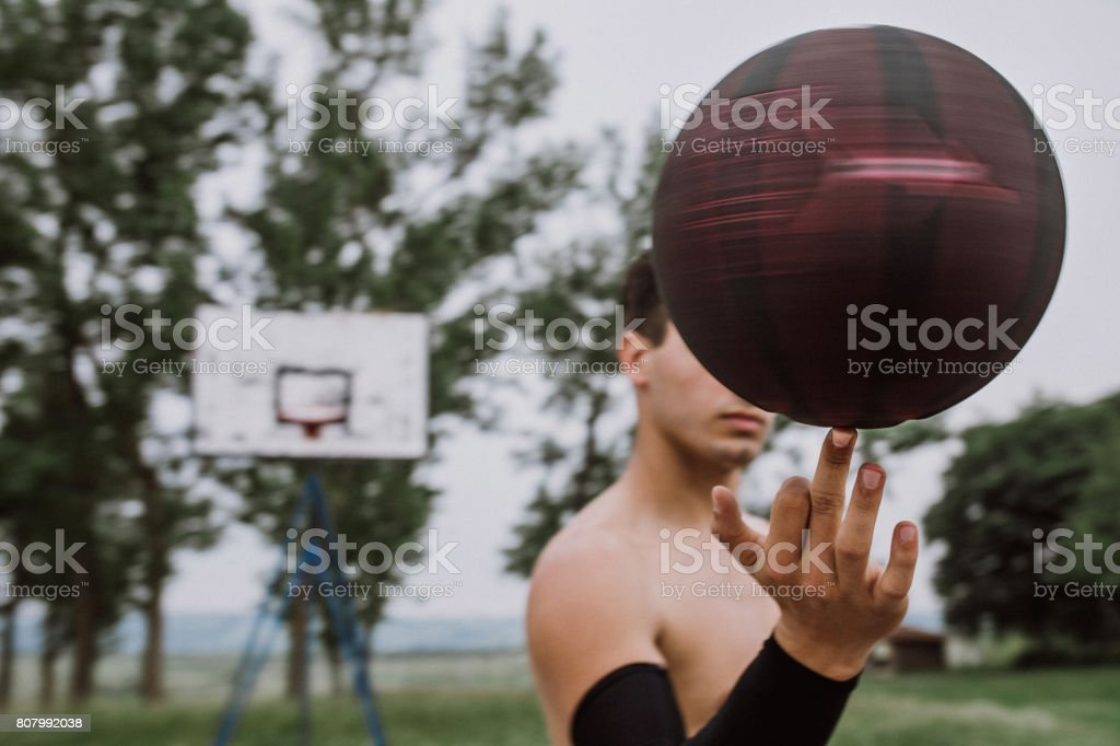 Streetball player showing his skill stock photo