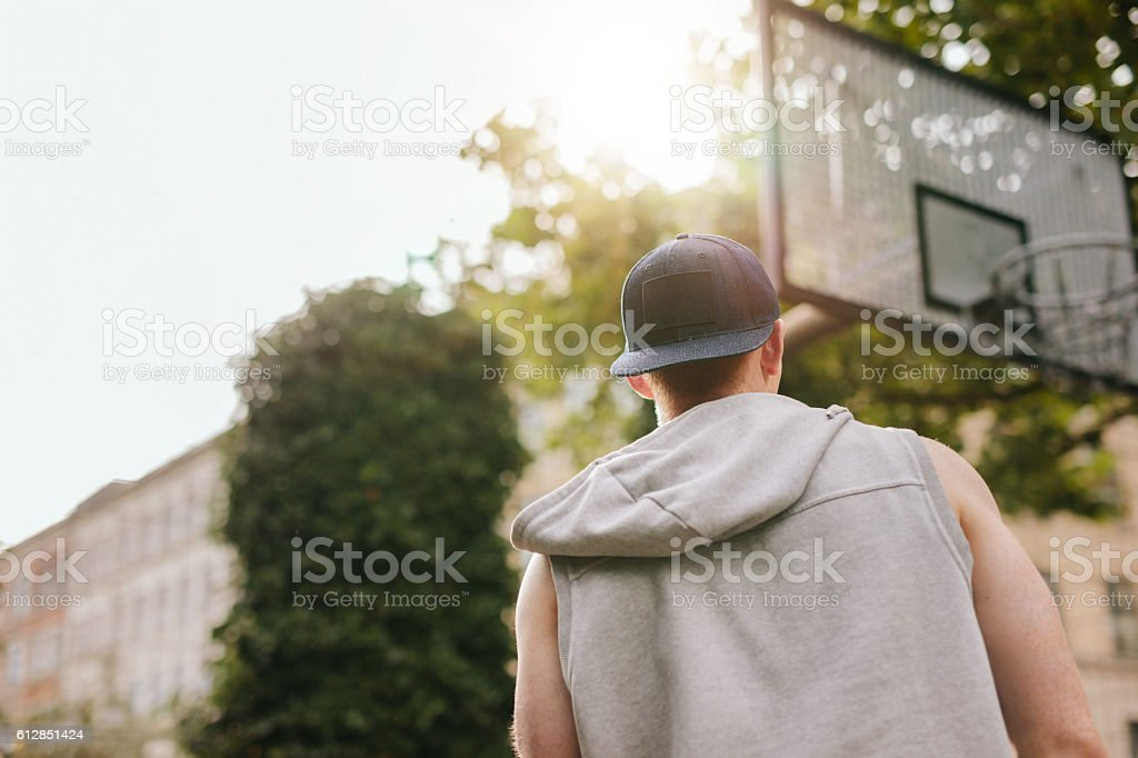 Streetball player standing outdoors on court stock photo