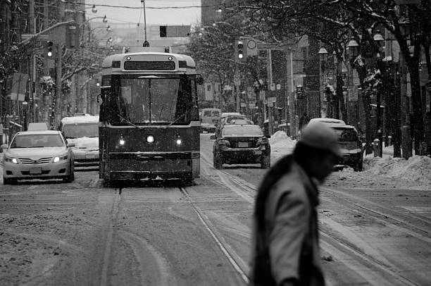 streetcar and intruder - toronto streetcar stock photos and pictures