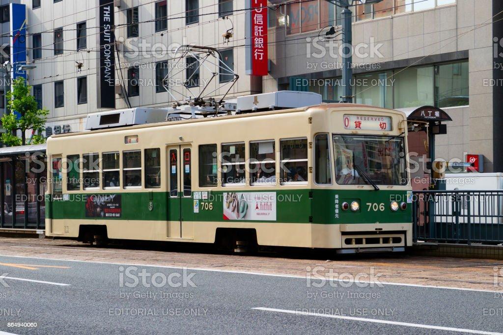 Streetcar as public transportation in Hatchobori street in Hiroshima stock photo